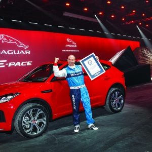 Jaguar stunt driver Terry Grant celebrates after setting a new Guinness World