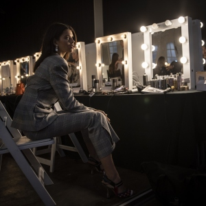 Model Georgia Fowler prepares backstage ahead of the Mercedes-Benz