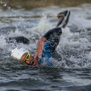 Athletes swim in the Main-Donau-Kanal during the DATEV Challenge