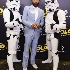 Actor Donald Glover and Stormtroopers